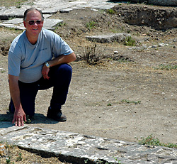 Leon Mauldin at the Erastus inscription in Ancient Corinth. Photo by Ferrell Jenkins.