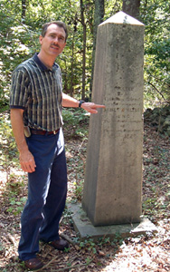Jeff Archer at the grave of James O'Kelly near Durham, NC. Photo by Ferrell Jenkins, BiblicalStudies.info.