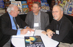 Anson Rainey and Steven Notley autograph a copy of The Sacred Bridge, Carta's Atlas of the Biblical World, for Ferrell Jenkins at the annual meeting, 2007.